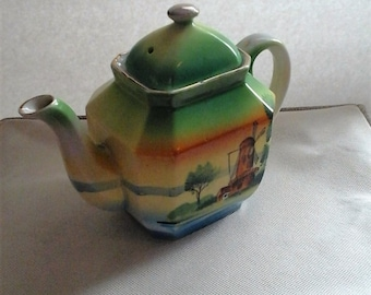 Japanese teapot with windmill scene