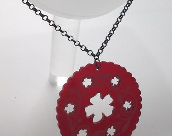 Red Dorcas pin tin inspired acrylic necklace pendant Laser cut from acrylic. by Emily M A Parkin