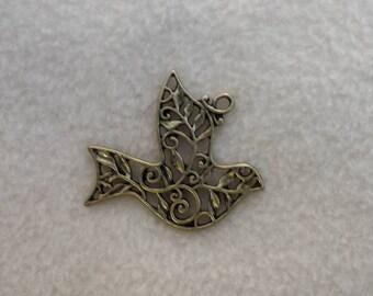 brass filigree bird in flight pendant