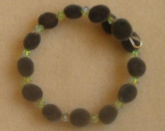 Handmade Hawaiian mgambo seed and chrysolite 2AB Swarovski crystal bracelet