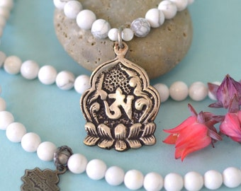 Tibetan OM Symbol on Lotus Pendant on Beaded Necklace with White Howlite, Blue Howlite & Labradorite
