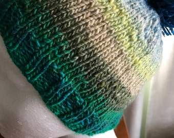 Child's hand knitted beanie with pompom | blue and green hues | Japanese Noro silk blend yarn
