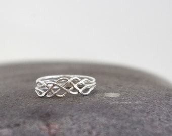 Discounted-- Celtic Puzzle Ring Size 7.75