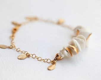 Om, Bracelet en porcelaine.