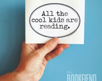 all the cool kids are reading oval bumper sticker or laptop decal