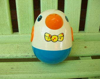 1970s Playskool Vintage Roly Poly Penguin - as the toy rolls around it there are bells -