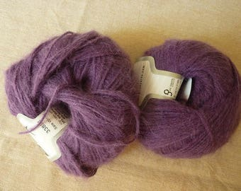 2 balls of a purple gorgeous kid mohair, nylon and acrylic blended