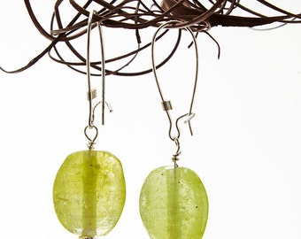 green glass bead earrings with silver detail