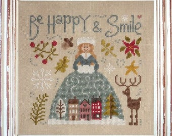 Be Happy and Smile – counted cross stitch chart to work in 14 colours of DMC thread.  Winter design, Houses, reindeer and Crinoline Lady.
