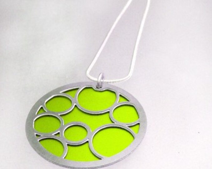 Round Pendant with Large Lime Bubbles on the front and Black on the back