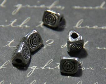 5 Silver triangular beads