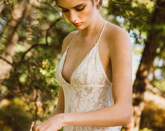 The Crete   by Elika In Love. The perfect beach wedding dress, this low back stretch lace gown is bohomian chic for the free spirited bride.