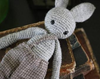 Grey rabbit in overalls