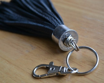 Black leather tassel keychain with real bullet casing