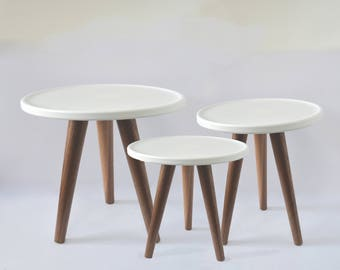 Round side table with rimed top in white top and 3 tapered walnut legs