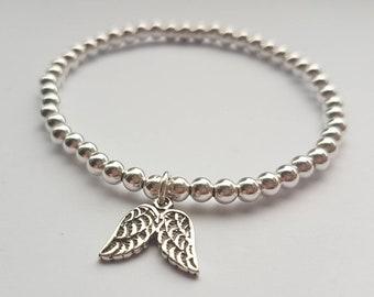 Sterling silver double angel wing charm beaded bracelet