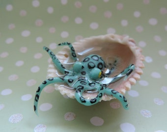 glowing blue polymer clay octopus