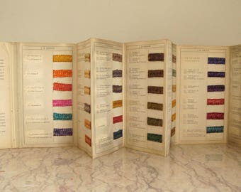 vintage 1920's sample book of dyes on straw
