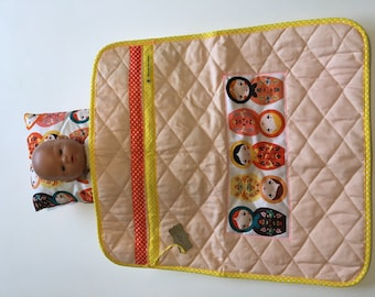 Quilted fishing with Russian dolls design cover