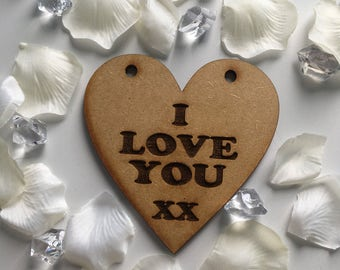 Laser engraved message heart