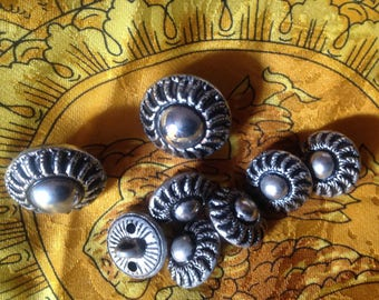 Set of eight vintage metal buttons