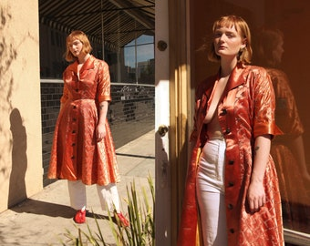Vintage 1950s Copper Orange Satin Button Front Dress with Embroidery and Exaggerated Collar and Cuff Details size Medium Large