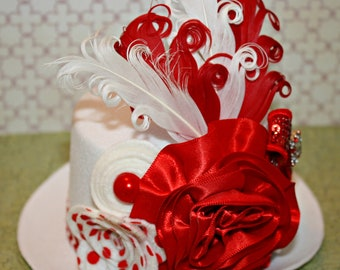 Red and white mini top hat fascinator with wool felt flowers, pearls, satin and feathers Photo prop