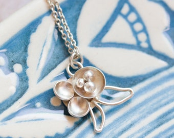 Floral charm sterling silver necklace