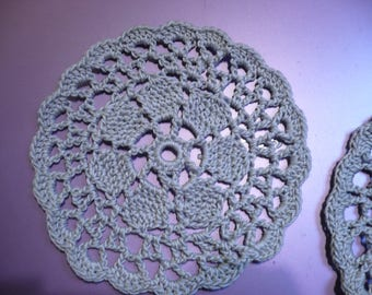 set of coasters crocheted in light gray cotton.