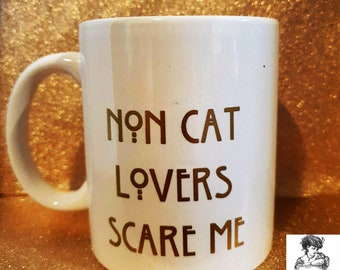 non cat lovers scare me mug