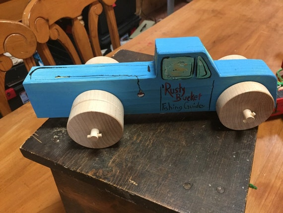 Rusty Bucket Fishing Tours Blue Wooden Toy Truck by Stan Altman