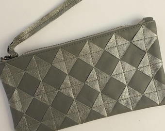 Metallic silver leather zip pouch. Repurposed silver leather diamond chips on gray leather, gunmetal zipper, fully lined.