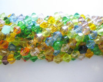 52 beads bicone faceted glass 7 x 6 mm
