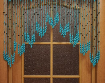 Crochet curtain on the doorway Tenderness, a turquoise curtain with coconut beads