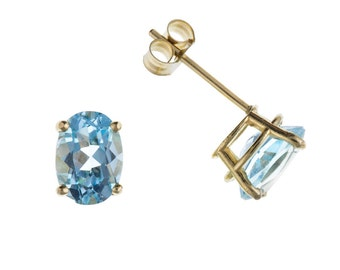 9ct Yellow Gold 7mm x 5mm Oval Blue Topaz Stud Earrings