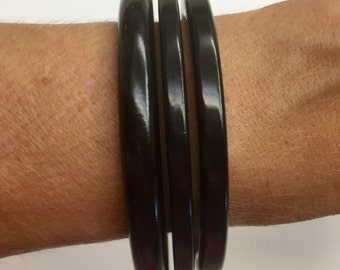 Bakelite bangles buy as lot, set or individually 85.00 this listing is for Black set ONLY