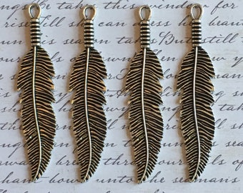 Four pewter feather pendents