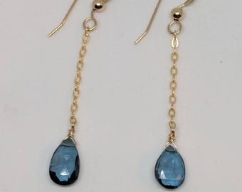 London blue topaz earrings. Gold or silver dangling drop earrings with London blue topaz gemstones