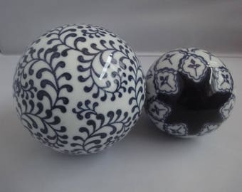 pair of Chinese Paperweights in blue and white  sizes dia 12cm & 9cm