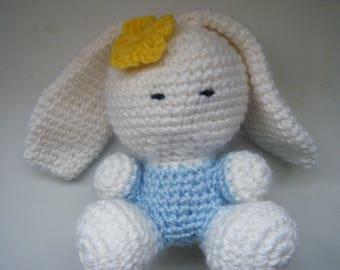 Amigurumi bunny with yellow flower
