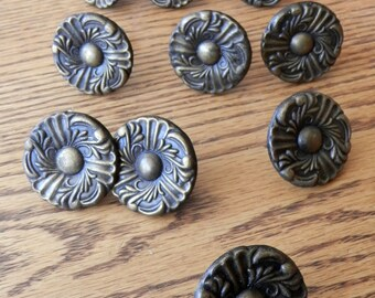 "ten (10) matching vintage antique brass knobs about 1 1/2"" dia"
