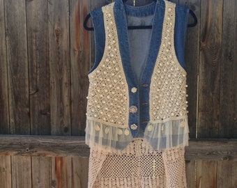 Women's denim vest with crocheted overlay, hand beaded with faux pearls, trimmed with lace, and a crocheted skirt. Finished with 3 buttons.