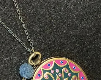 """Beautiful magnetic locket on 30 """" chain with blue lava bead to where your essintial oils everywhere you go."""