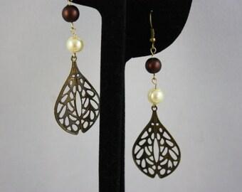 bronze drop earrings; drop earrings; bronze earrings; earrings; bronze and pearl earrings; filigree drop earrings; fiigree earrings
