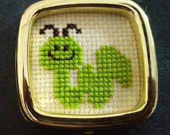 Counted cross stitch magnet worm