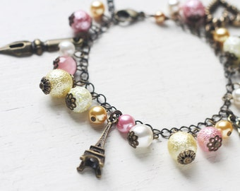 Romantic Paris Charm Bracelet in Antique Brass - Eiffel Tower Writing Themed Bracelet in Pastel Pink and Yellow