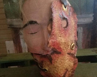 Flesh mask half face.