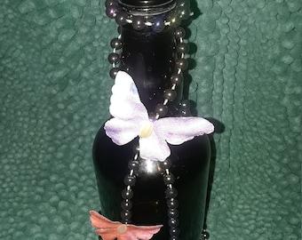 Butterfly motif glass bottle