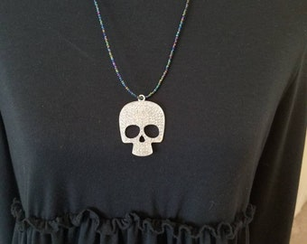 Long length beaded necklace with sparkle skull pendant