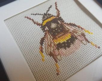 Cross Stitch Bee in Black frame.